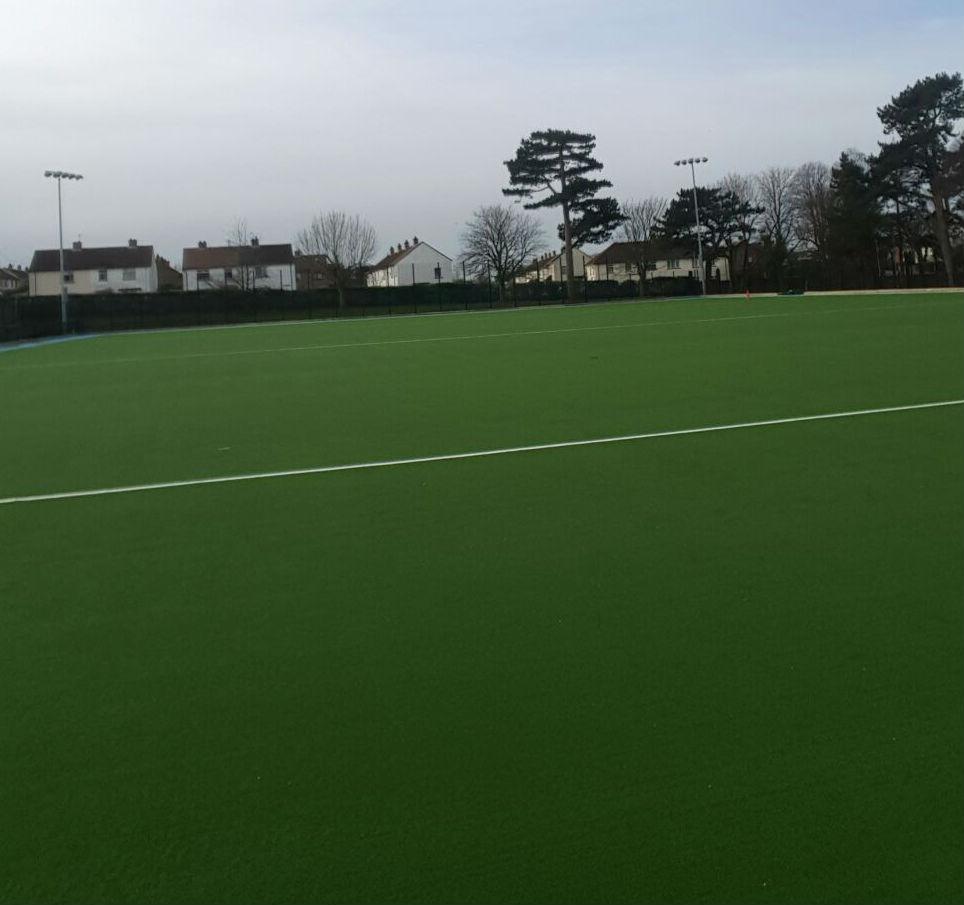 Artificial grass hockey pitch installation at Sullivan Upper School Belfast - PST Sport artificial grass specialists
