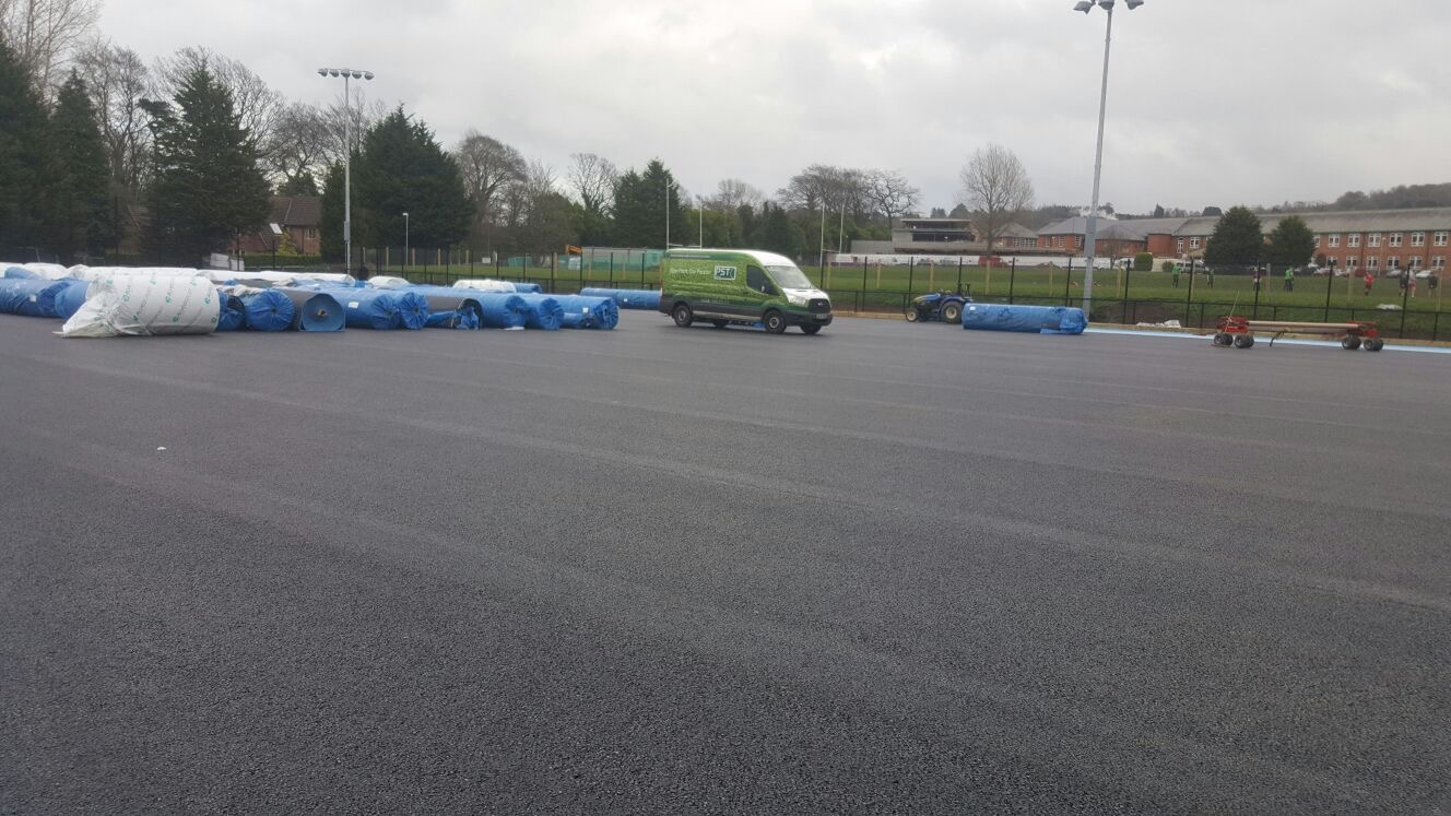 Artificial grass hockey pitch installation at Sullivan Upper School Belfast - PST Sport