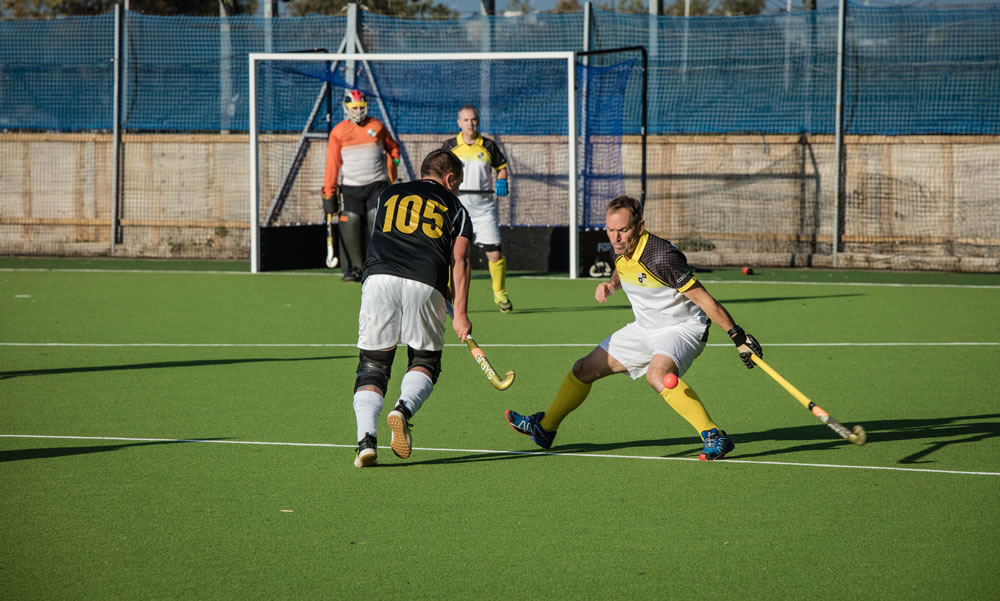 mens training on the new artificial turf hockey pitch